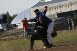 Stefan Allen of the Native Yankees, top, miraculously avoids getting tagged out by Douglas Keevik of the Barry Pickers during the final game of Inuvik's 2019 Midnight Sun Softball Tournament on Aug. 5.