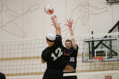 Edouard Bélanger from the Aklavik Outlaws rises up to block a spike from Tuk U's Gerald Stuart during the men's final game of the region's first northern Territorial Volleyball Tournament on March 2, 2019.