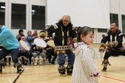 Drum dance during the opening ceremonies for the 2019 Northern and Dene Games Summit in Inuvik in March. Photobombed by Payton Inglangasuk.