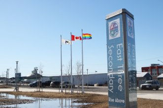 The Pride flag flies high outside of Inuvik's East Three schools on May 17.