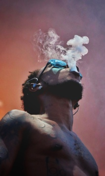 Slim Jxmmi of Rae Sremmurd blows smoke out of his mouth during the group's performance at the Ottawa Bluesfest music festivalon July 14, 2018. Shot for The Charlatan