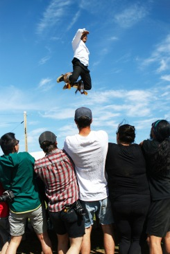 Jimmy Kalinek soars high in the sky during a blanket toss activity that was hosted during Inuvik's National Indigenous Day celebrations on June 21, 2019. Shot for Inuvik Drum