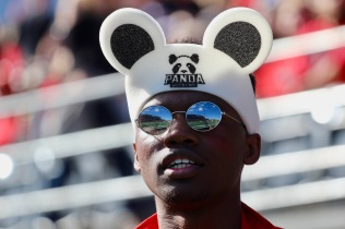A fan watches the 49th annual Panda Game football match between the University of Ottawa GeeGees and the Carleton University Ravens at TD Stadium in Ottawa, Ont., on Sept. 30, 2017. The Ravens won 33-30 in OT, in front of a sellout crowd of 24,420 people. Shot for The Charlatan