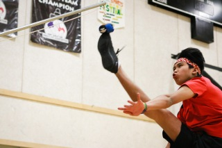 Joel Arey, 15, kicks a ball that stands at a height of 7 ft and 6 inches during a One-Foot High Kick tournament during the 2019 Northern and Dene Games Summit in Inuvik, N.W.T. in March.