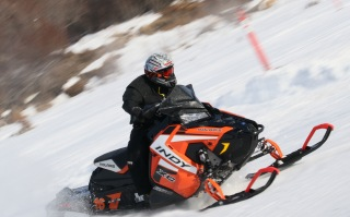 A ski-doo racer flies around the corner of the race track for the men's ski-doo race event during Inuvik's 62nd annual Muskrat Jamboree, which took place down by the frozen Mackenzie River on April 6, 2019.