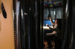 Canadian animator Richard Reeves examines a strip of film in his Creston home studio. November 2020. Shot for the Creston Valley Advance