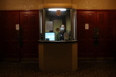 Tivoli Theatre employee Noah Doyle sits inside of the theatre's ticket booth during its soft-opening night on Oct. 26, where they hosted the second annual 7th Siding Film Festival's third screening event. Shot for the Creston Valley Advance
