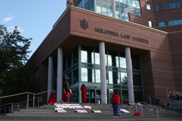Three women — Meagan Louis, Carol Laboucan and one who asked to remain anonymous — stood at the top of the Kelowna courthouse's steps on June 10, 2021, condemning Curtis Sagmoen and violence against women.