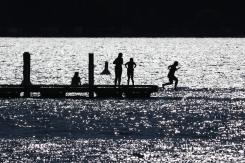 People go for a swim in Okanagan Lake in Kelowna. June 2021